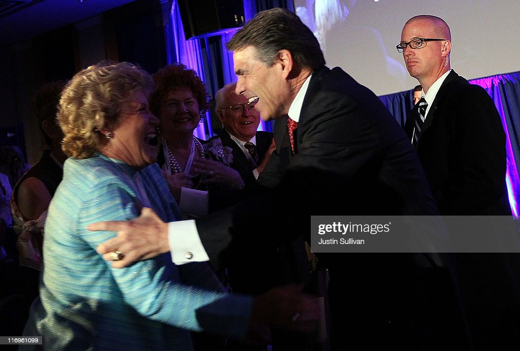 Texas governor Rick Perry greets a supporter during the 2011 Republican Leadership Conference on June 18, 2011 in New Orleans, Louisiana. The 2011 Republican Leadership Conference features keynote addresses from most of the major republican candidates for president as well as numerous republican leaders from across the country.