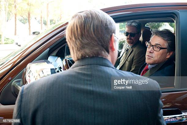 Texas Governor Rick Perry is greeted by CEO of Toyota North America Jim Lentz before the Toyota 'Hello Texas' event on October 27 2014 in Plano Texas