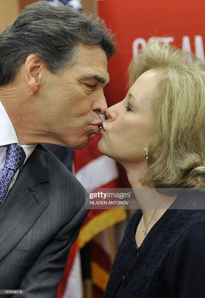 Texas Governor Rick Perry kisses his wife Anita after he announced that he is suspending his campaign as a Republican presidential candidate on January 19, 2012, in Charleston, South Carolina, in advance of this weekend's January 21, 2012 Republican presidential primary. AFP PHOTO/Mladen ANTONOV