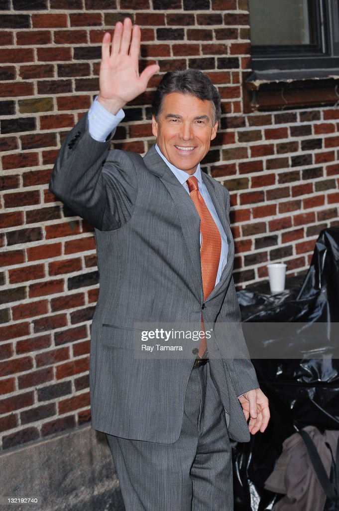 Texas Governor <a gi-track='captionPersonalityLinkClicked' href=/galleries/search?phrase=Rick+Perry+-+Homme+politique&family=editorial&specificpeople=175872 ng-click='$event.stopPropagation()'>Rick Perry</a> (R) leaves the 'Late Show With David Letterman' taping at the Ed Sullivan Theater on November 10, 2011 in New York City.