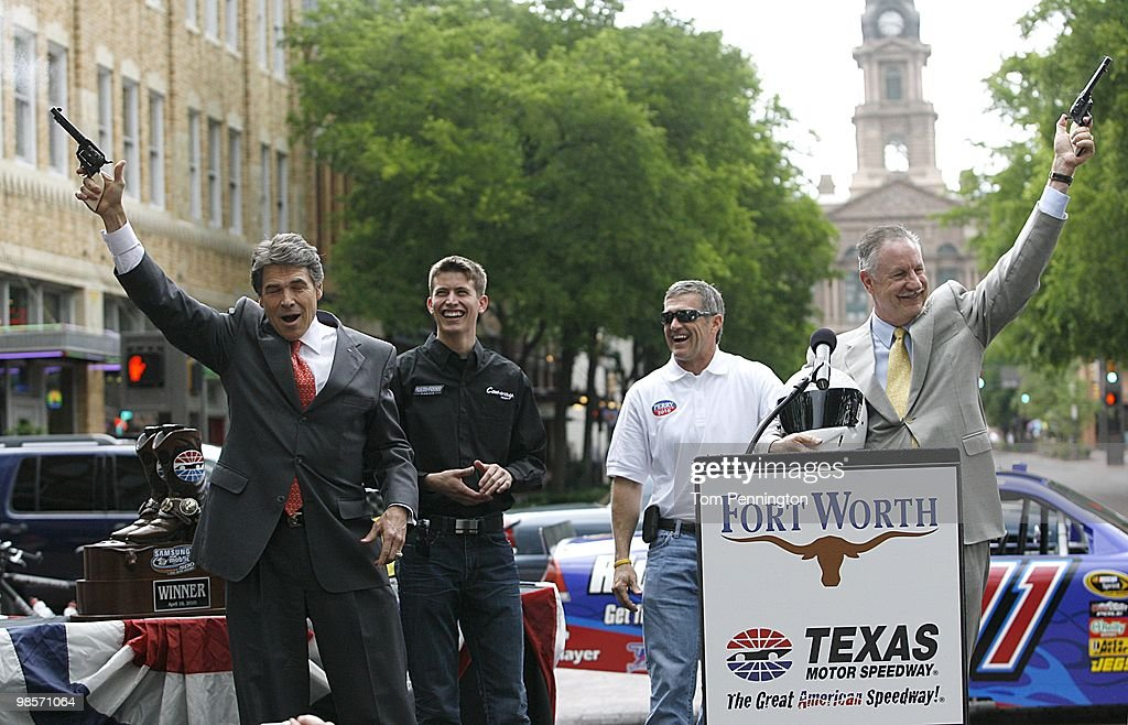 Texas Governor Rick Perry left and Fort Worth mayor Mike Moncrief right fire sixshooter pistols with NASCAR drivers Colin Braun and Bobby Labonte...