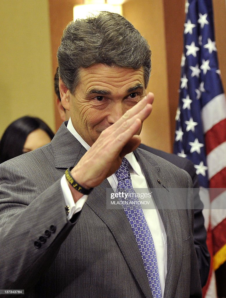 Texas Governor Rick Perry salutes after announcing that he is suspending his campaign as a Republican presidential candidate, January 19, 2012, in Charleston, South Carolina, in advance of this weekend's January 21, 2012 Republican presidential primary. AFP PHOTO/Mladen ANTONOV