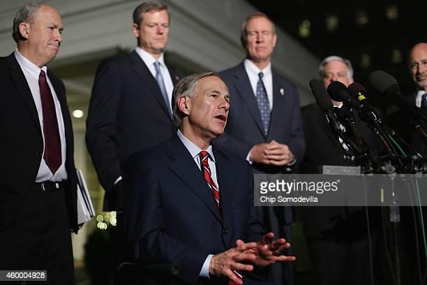 Texas Governorelect Greg Abbott talks with reporters with Alaska Gov Bill Walker Massachusetts Governorelect Charlie Baker Illinois Governorelect...