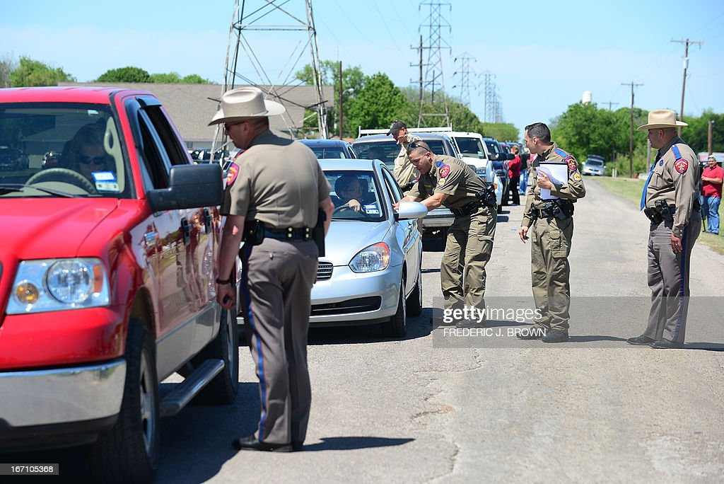 Texas Highway Patrol officers take down details and mark the vehicles of residents allowed to return to their destroyed homes near the site of the April 17 fertilizer plant blast in West, Texas, on April 20, 2013. Investigators have been treating the blast site as a crime scene, although authorities say the blast was likely caused by a fire at the West Fertilizer Company, and access to the area has been restricted until today with residents allowed to return. Debby's home near the Intermediate school was among those destroyed but she was not home at the time, and though her husband was, he survived with injuries resulting in some forty stitches. AFP PHOTO/Frederic J. BROWN