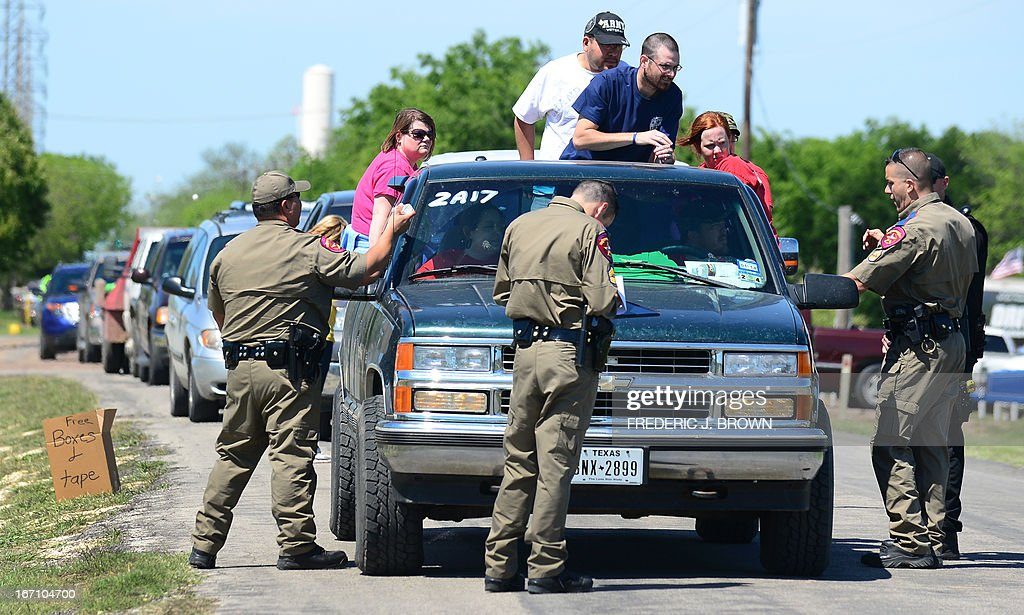 Texas Highway Patrol officers take down the details and mark the vehicles of residents being allowed to return to their destroyed homes near the site of the April 17 fertilizer plant blast in West, Texas ,on April 20 2013. Investigators have been treating the blast site as a crime scene, although authorities say the blast was likely caused by a fire at the West Fertilizer Company, and access to the area has been restricted untl today with residents allowed to return. AFP PHOTO/Frederic J. BROWN