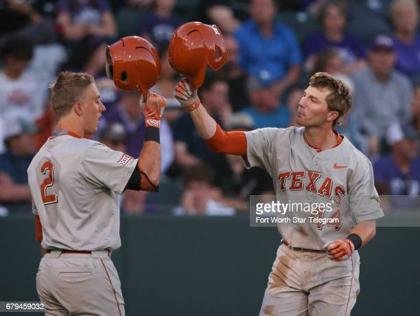 Texas' Kody Clemens taps helmets with Austin Todd after a home run in the third inning against Texas Christian at Lupton Stadum in Fort Worth Texas...