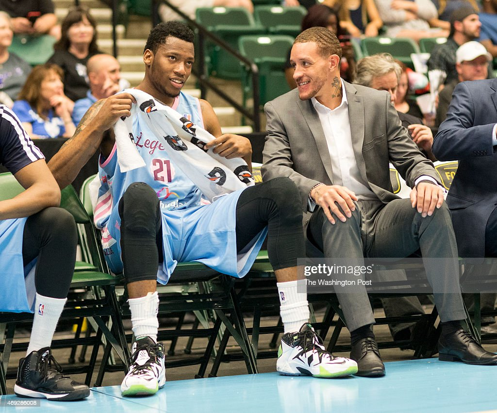 Texas Legends basketball player Delonte West chats with teammate Eric Griffin on the bench at the Dr Pepper Arena on April 1 2015 in Frisco Texas The...