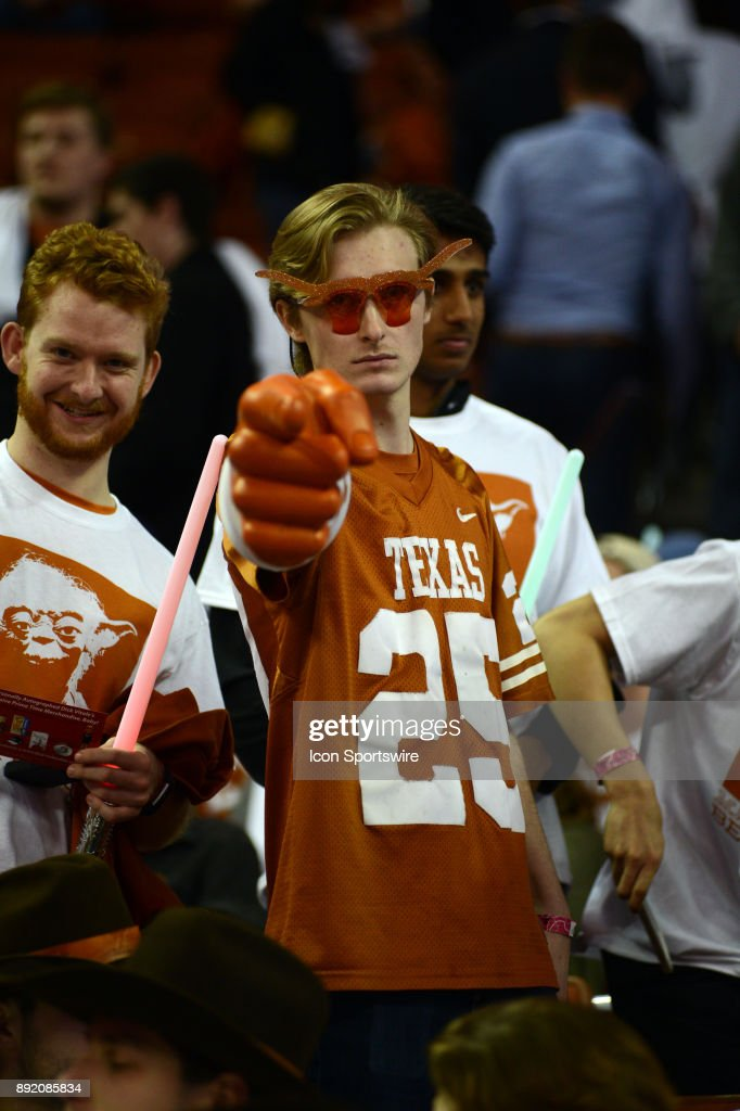 A Texas Longhorn fan cheers during the Texas Longhorns 59 - 52 loss to the Michigan Wolverines on December 12, 2017 at the Frank Erwin Center in Austin, TX.