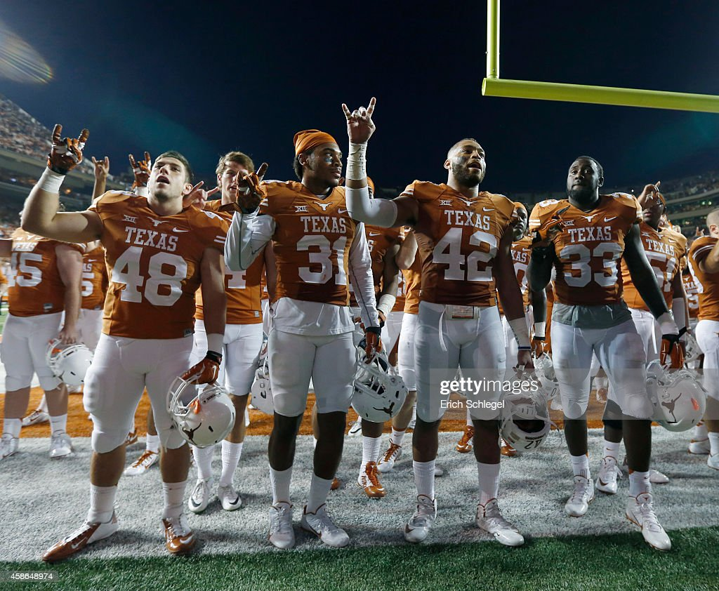 Texas Longhorn football players sing 'The Eyes of Texas' after beating West Virginia 3316 in the NCAA Big 12 game between the Texas Longhorns and the...