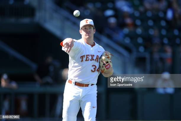 Texas Longhorn pitcher Kyle Johnston makes a throw to 1st base during game between the Texas Longhorns and the UConn Huskies on February 25 2017 at...