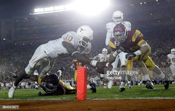 Texas Longhorn quarterback Vince Young scores a touch down in the third quarter against USC at the national championship game at the Rose Bowl in...