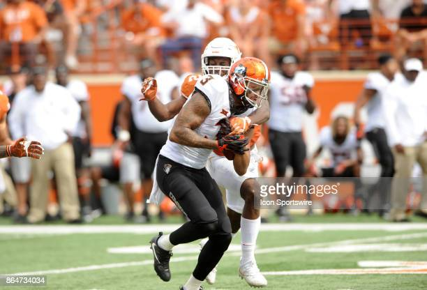 Texas Longhorns CB Kris Boyd tackles Oklahoma State Cowboys WR Marcell Ateman during game featuring The Oklahoma State Cowboys and the Texas...