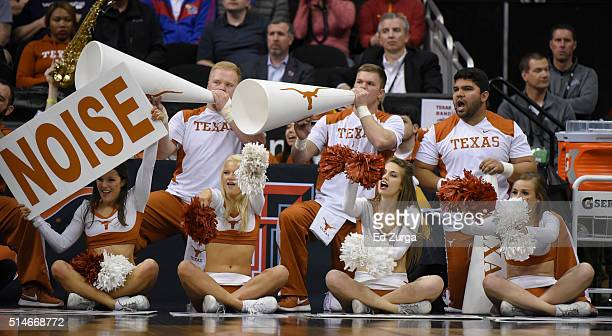 Texas Longhorns cheerleaders support their team during a game against the Baylor Bears in the first half during the quarterfinals of the Big 12...
