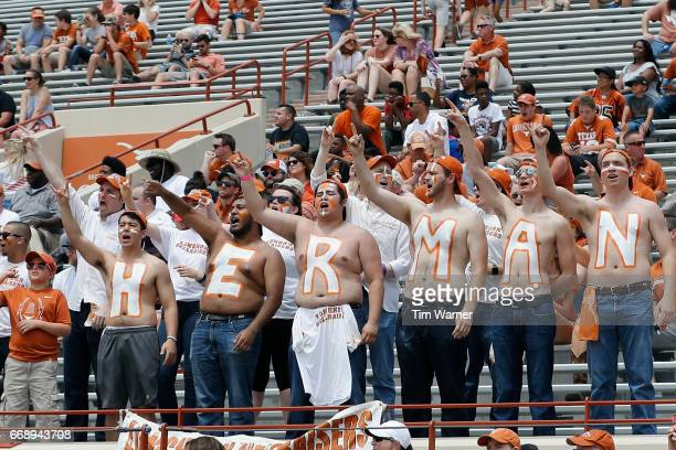 Texas Longhorns fans paint their chests with the name of head coach Tom Herman during the OrangeWhite Spring Game at Darrell K RoyalTexas Memorial...