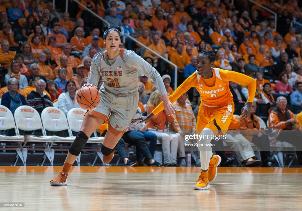 Texas Longhorns forward Audrey-Ann Caron-Goudreau (31) drives around Tennessee Lady Volunteers guard/forward Rennia Davis (0) during a game between the Texas Longhorns and Tennessee Lady Volunteers on December 10, 2017, at Thompson-Boling Arena in Knoxville, TN. Tennessee defeated Texas 82-75.