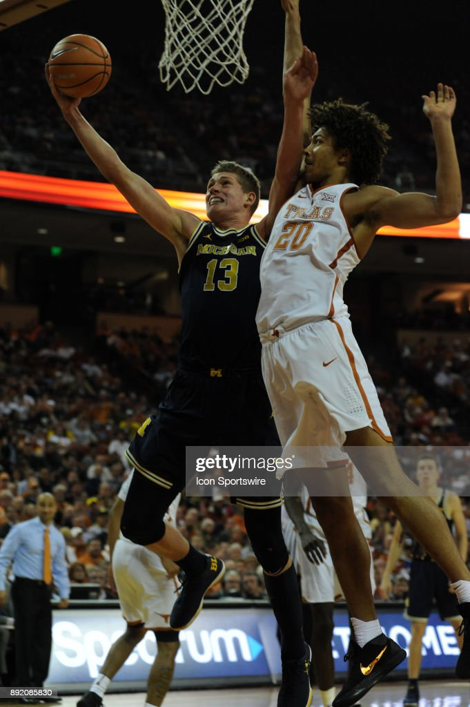 Texas Longhorns forward Jericho Sims (20) defends Michigan Wolverines center Moritz Wagner (13) during the Texas Longhorns 59 - 52 loss to the Michigan Wolverines on December 12, 2017 at the Frank Erwin Center in Austin, TX.