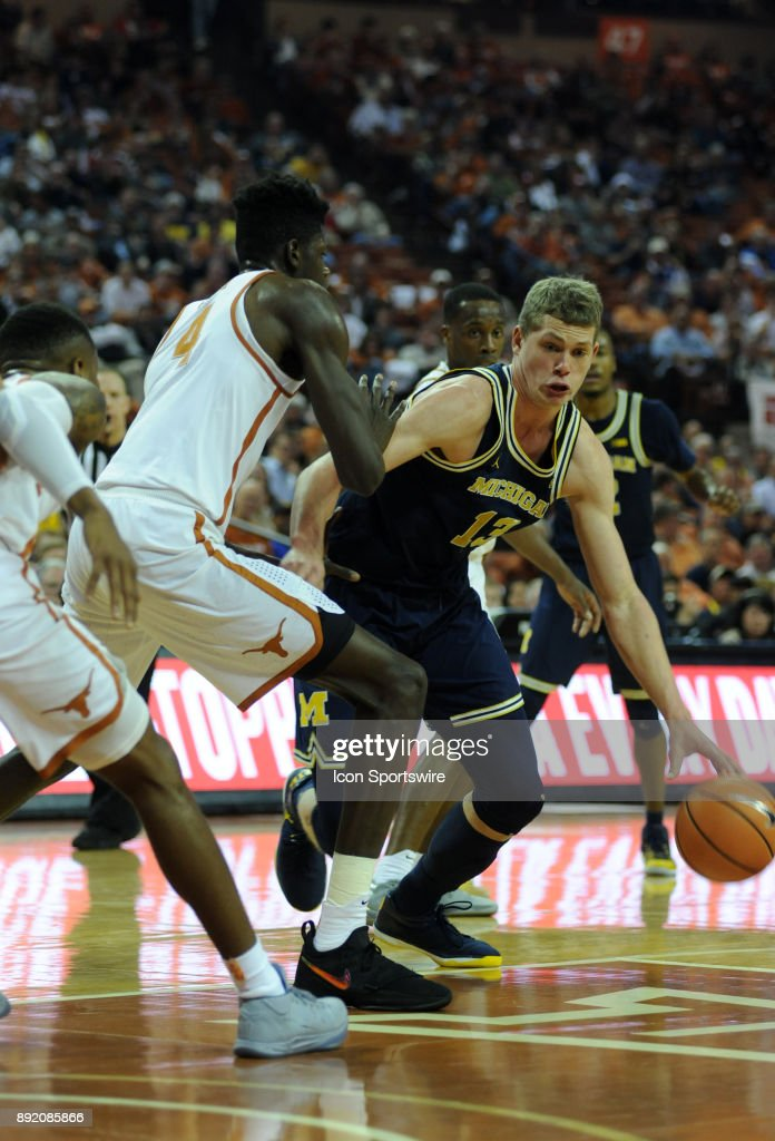 Texas Longhorns forward Mohamed Bamba (4) defends Michigan Wolverines center Moritz Wagner (13) during the Texas Longhorns 59 - 52 loss to the Michigan Wolverines on December 12, 2017 at the Frank Erwin Center in Austin, TX.
