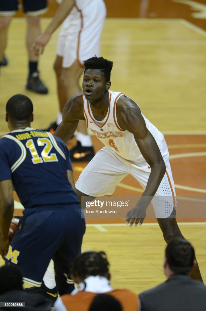 Texas Longhorns forward Mohamed Bamba guards Michigan Wolverines player Muhammad-Ali Abdur-Rahkman during 59 - 52 loss to the Michigan Wolverines on December 12, 2017 at the Frank Erwin Center in Austin, TX.