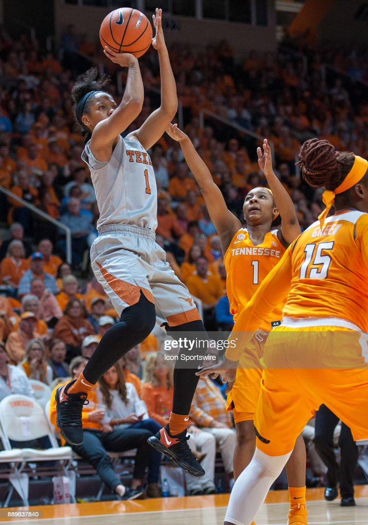 Texas Longhorns guard Alecia Sutton (1) shoots over Tennessee Lady Volunteers guard Anastasia Hayes (1) during a game between the Texas Longhorns and Tennessee Lady Volunteers on December 10, 2017, at Thompson-Boling Arena in Knoxville, TN. Tennessee defeated Texas 82-75.
