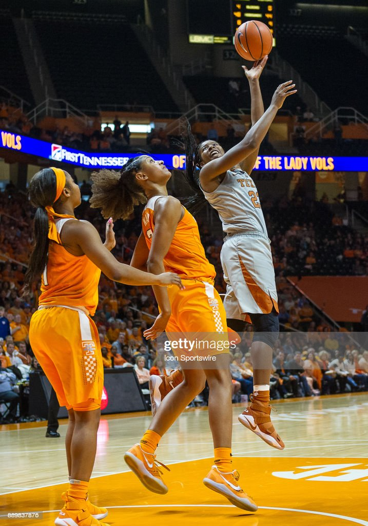 Texas Longhorns guard Ariel Atkins (23) shooting over Tennessee Lady Volunteers guard/forward Jaime Nared (31) during a game between the Texas Longhorns and Tennessee Lady Volunteers on December 10, 2017, at Thompson-Boling Arena in Knoxville, TN. Tennessee defeated Texas 82-75.