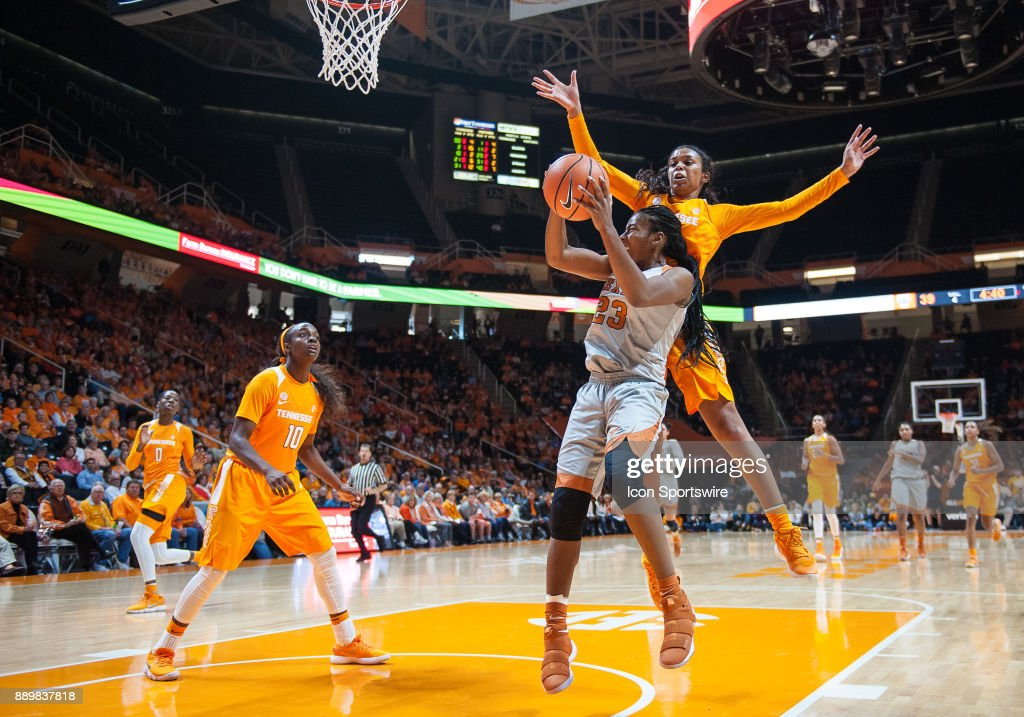 Texas Longhorns guard Ariel Atkins (23) shoots around Tennessee Lady Volunteers guard Evina Westbrook (2) during a game between the Texas Longhorns and Tennessee Lady Volunteers on December 10, 2017, at Thompson-Boling Arena in Knoxville, TN. Tennessee defeated Texas 82-75.