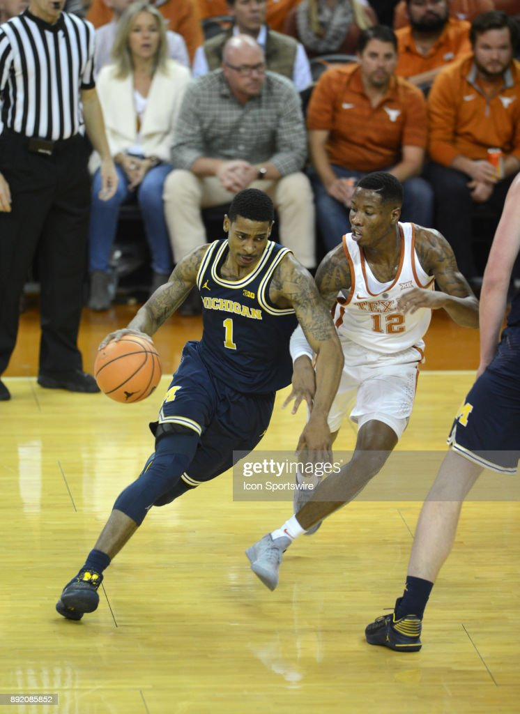 Texas Longhorns guard Kerwin Roach II (12) chases Michigan Wolverines guard Charles Matthews (1) during the Texas Longhorns 59 - 52 loss to the Michigan Wolverines on December 12, 2017 at the Frank Erwin Center in Austin, TX.