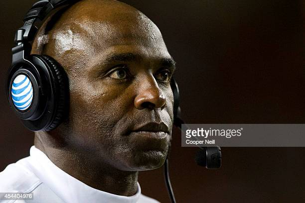 Texas Longhorns head coach Charlie Strong looks on against the North Texas Mean Green on August 30 2014 at Darrell K RoyalTexas Memorial Stadium in...