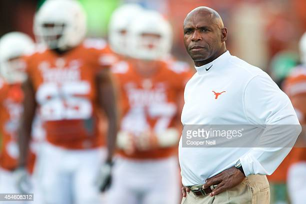 Texas Longhorns head coach Charlie Strong looks on during warmups before kickoff against the North Texas Mean Green on August 30 2014 at Darrell K...