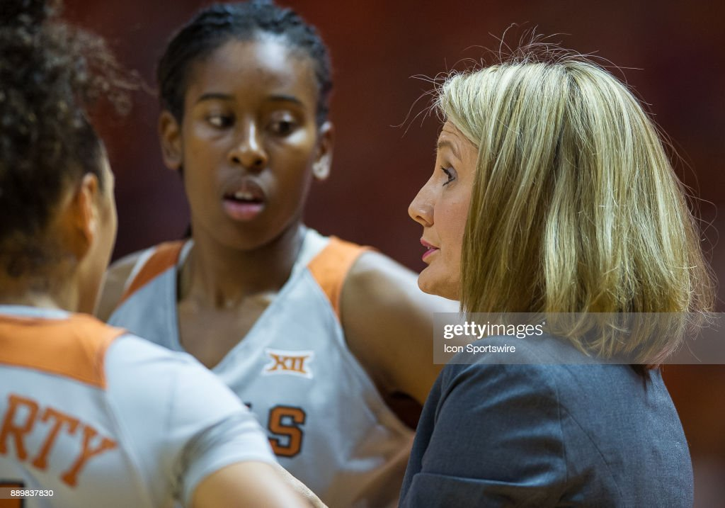 Texas Longhorns head coach Karen Aston talks to her players during a game between the Texas Longhorns and Tennessee Lady Volunteers on December 10, 2017, at Thompson-Boling Arena in Knoxville, TN. Tennessee defeated Texas 82-75.