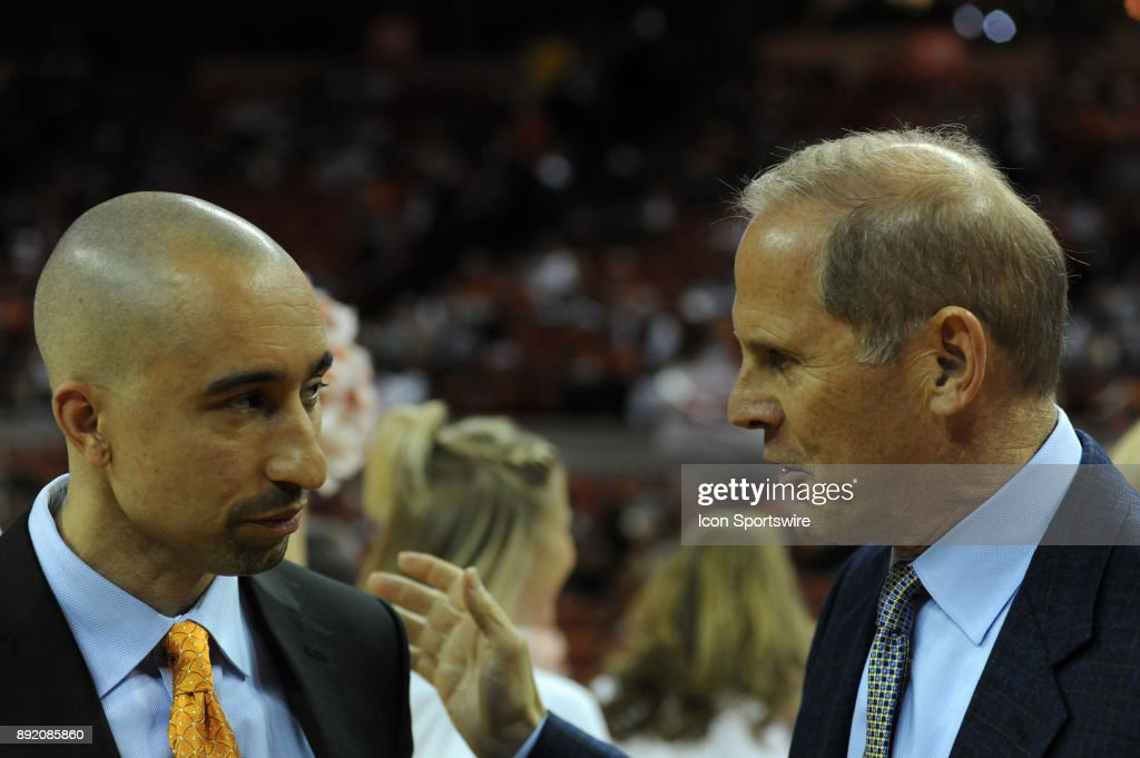 Texas Longhorns head coach Shaka Smart (left) chats with Michigan Wolverines head coach John Beilein (right) prior to the Texas Longhorns 59 - 52 loss to the Michigan Wolverines on December 12, 2017 at the Frank Erwin Center in Austin, TX.