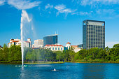 Texas Medical Center skyline in Houston, with Hermann Park (including a small lake and fountain) in the foreground.  The Texas Medical Center is the largest medical center in the world, employing over