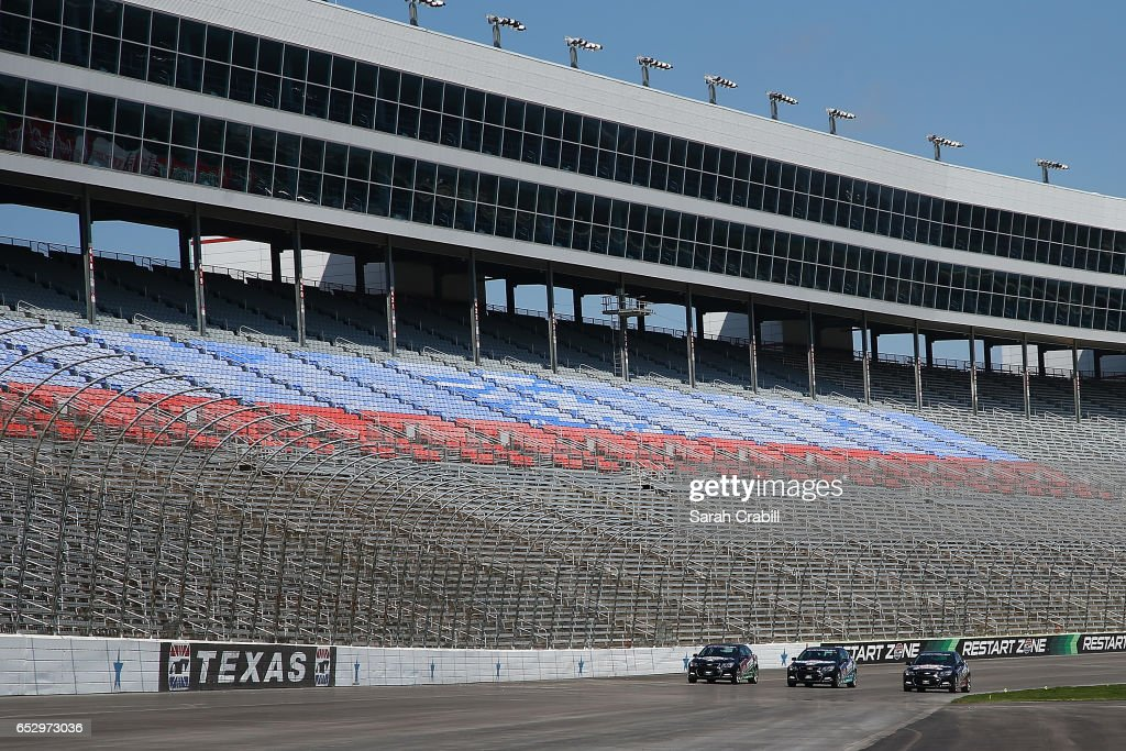 Texas Motor Speedway President, Eddie Gossage, Monster Energy NASCAR Cup Series driver for JTG Daugherty Racing, Chris Buescher, and Verizon IndyCar Series driver and owner for Ed Carpenter Racing, Ed Carpenter drive pace cars during the Texas Motor Speedway Track Renovation Unveiling at Texas Motor Speedway on March 13, 2017 in Fort Worth, Texas.
