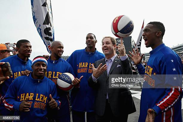 Texas Motor Speedway President Eddie Gossage poses with the Harlem Globetrotters during prerace ceremonies for the NASCAR Sprint Cup Series AAA Texas...