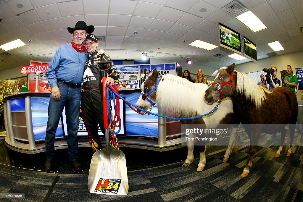 Texas Motor Speedway President Eddie Gossage (L) presents retiring driver Jeff Gordon with Shetland ponies for his kids during a press conference at Texas Motor Speedway on November 6, 2015 in Fort Worth, Texas.