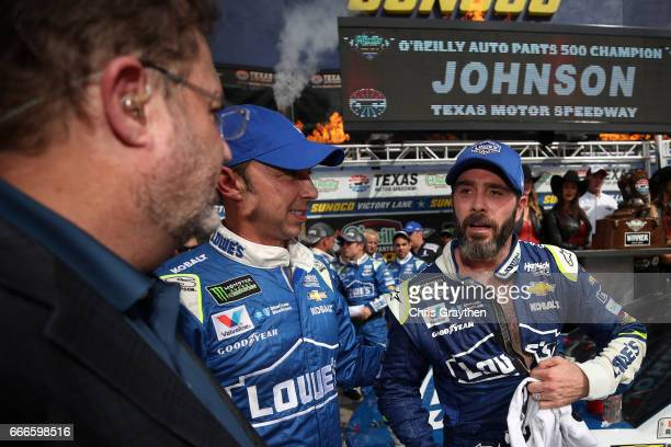 Texas Motor Speedway President Eddie Gossage talks with Jimmie Johnson driver of the Lowe's Chevrolet and his crew chief Chad Knaus after winning the...