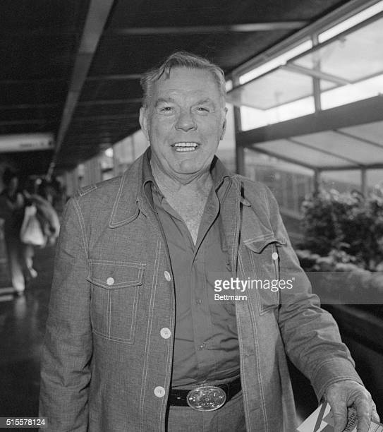 Texas oil disaster expert Red Adair smiles as waits in an airport on his way Stavanger Norway and the Bravo platform in the Ekofisk field There he is...