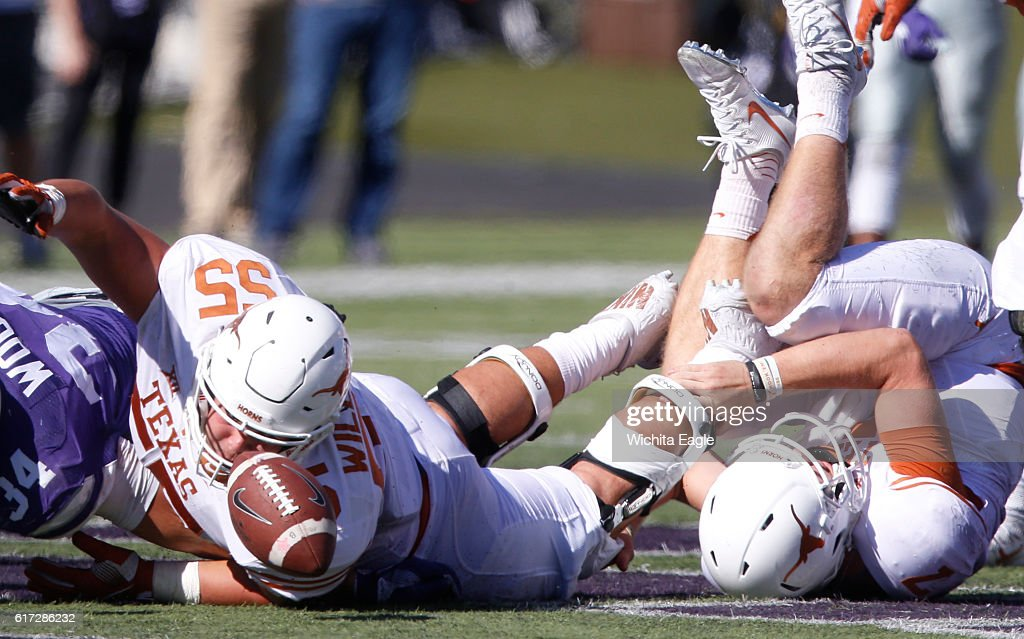 Texas quarterback Shane Buechele (7) fumbles the ball after being hit behind the line of scrimmage in the second half agianst Kansas State as Texas offensive lineman Connor Williams (55) gives chase at Snyder Family Stadium in Manhattan, Kan., on Saturday, Oct. 22, 2016. Kansas State won, 24-21.