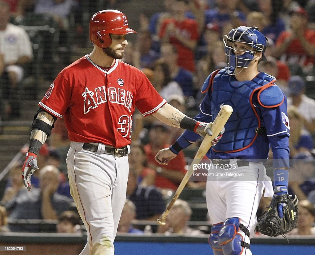 Texas Rangers catcher A.J. Pierzynski, right, looks on as Josh Hamilton of the Los Angeles Angels reacts to striking out in the eighth inning at the Rangers Ballpark in Arlington on Friday, September 27, 2013, in Arlington, Texas. The Rangers won, 5-3.
