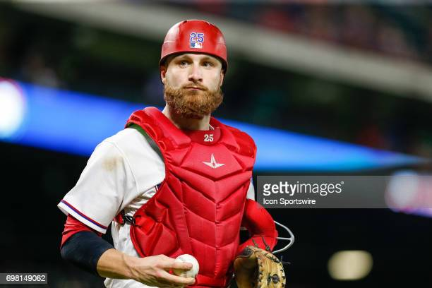 Texas Rangers catcher Jonathan Lucroy looks for a kid to toss the ball to as he heads off the field during the MLB game between the Toronto Blue Jays...