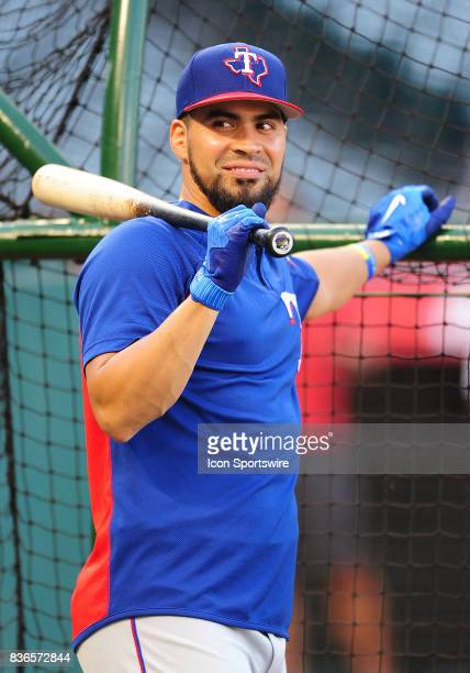 Texas Rangers catcher Robinson Chirinos leans on the batting cage during batting practice before a game against the Los Angeles Angels of Anaheim on...