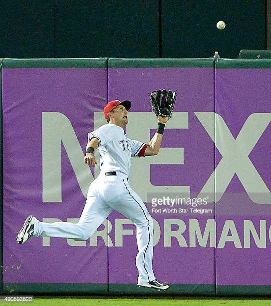 Texas Rangers center fielder Drew Stubbs catches a drive by the Detroit Tigers' to end the game at Globe Life Park in Arlington Texas on Tuesday Sept...