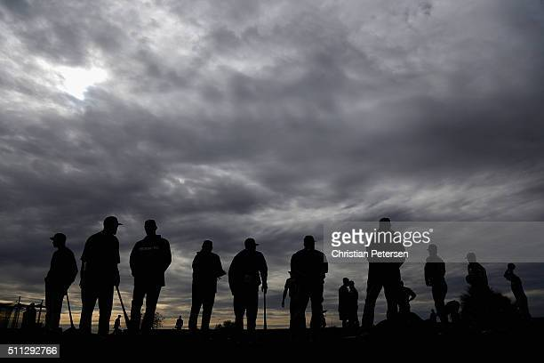 Texas Rangers coaches pitchers and catchers participate in a spring training workout at Surprise Stadium on February 19 2016 in Surprise Arizona