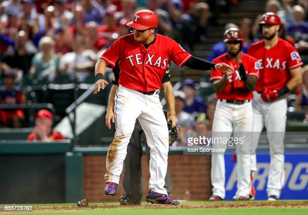 Texas Rangers DH ShinSoo Choo is safe at home plate during the MLB game between the Chicago White Sox and Texas Rangers on August 17 2017 at Globe...