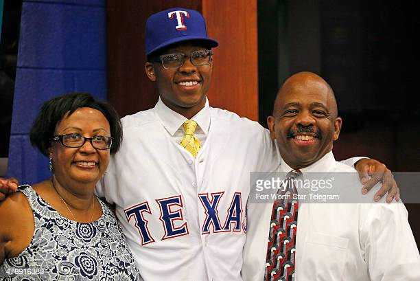 Texas Rangers draft pick UC Santa Barbara pitcher Dillon Tate with his mother Lenora and father Anthony during a news conference at Globe Life Park...