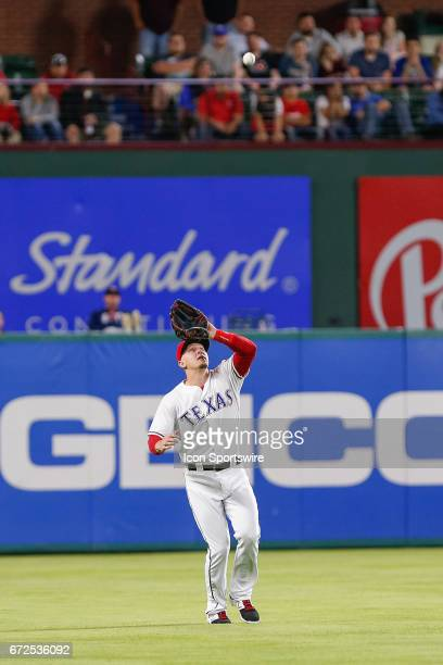 Texas Rangers First base Ryan Rua makes a play on a pop fly during the MLB game between the Minnesota Twins and Texas Rangers on April 24 2017 at...