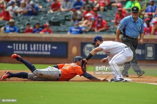 Texas Rangers first baseman Joey Gallo attempts to tag Houston Astros center fielder George Springer during the game between the Houston Astros and...