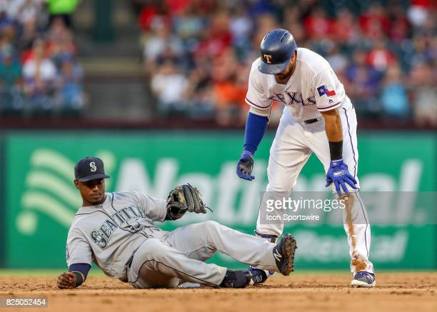 Texas Rangers first baseman Joey Gallo is safe at second baseman against shortstop Jean Segura during the MLB game between the Seattle Mariners and...