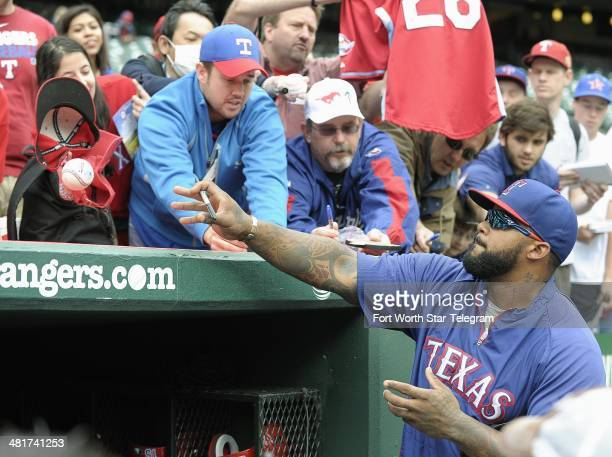Texas Rangers first baseman Prince Fielder signs autographs before the game against the Philadelphia Phillies on Opening Day Monday March 31 at the...