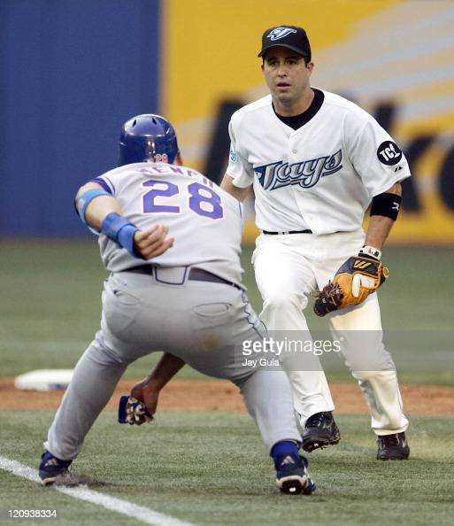 Texas Rangers Kevin Mench is caught in a rundown by Toronto Blue Jays SS John McDonald and was eventually tagged out in MLB action at Rogers Centre...
