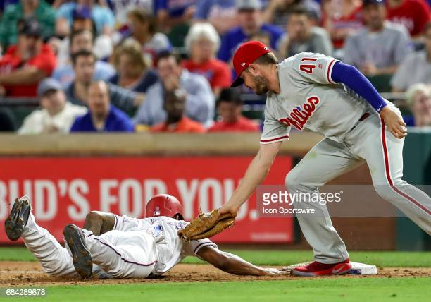 Texas Rangers left fielder Delino DeShields gets back to first base as Phillies first baseman Brock Stassi applies the tag during the MLB game...